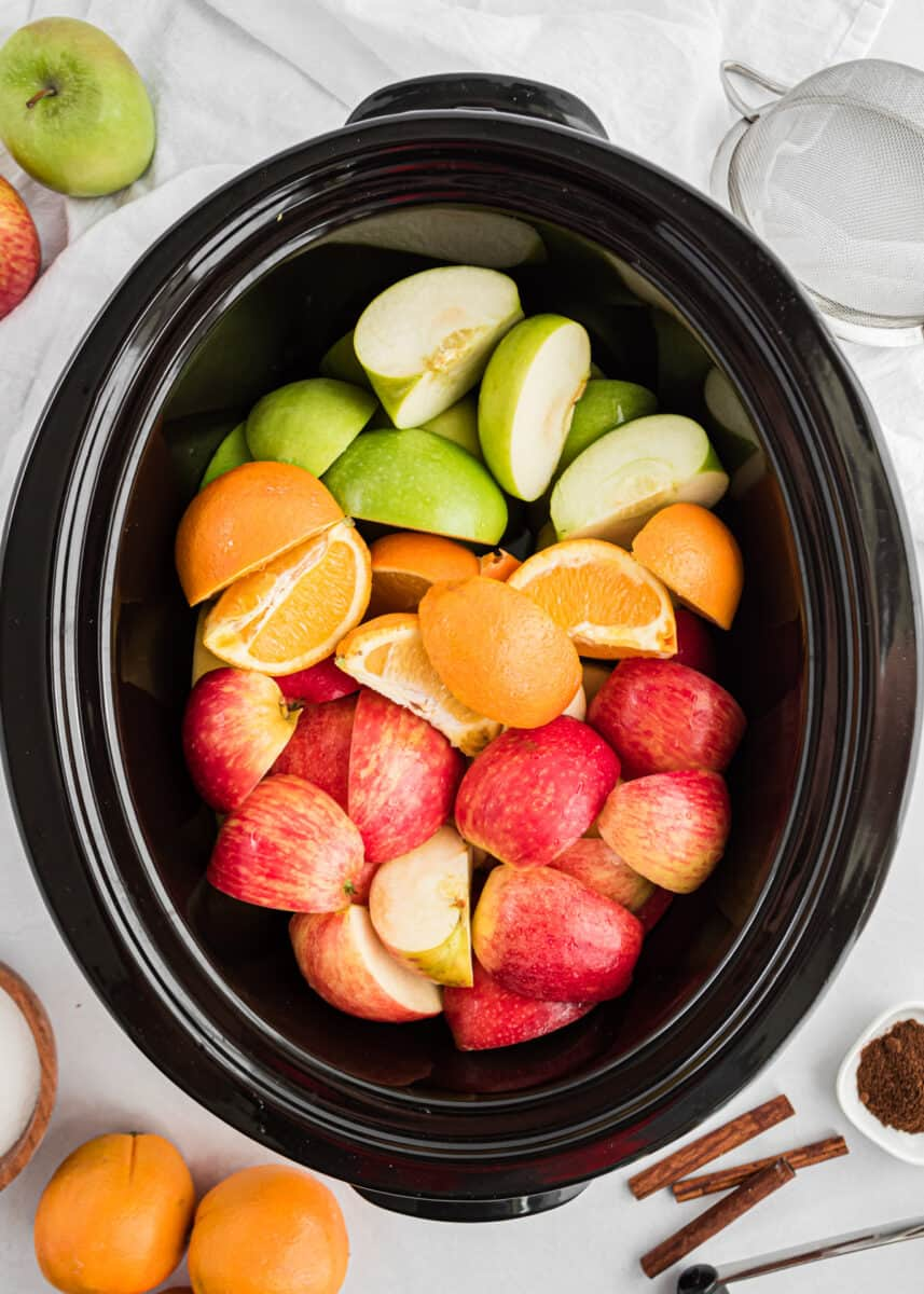 crockpot full of apples and oranges