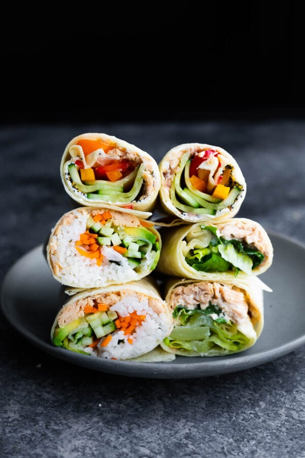 stack of six salmon wraps on a plate