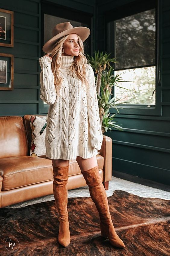 Cute Thanksgiving outfits with tan over the knee boots, cream sweater dress and fedora hat