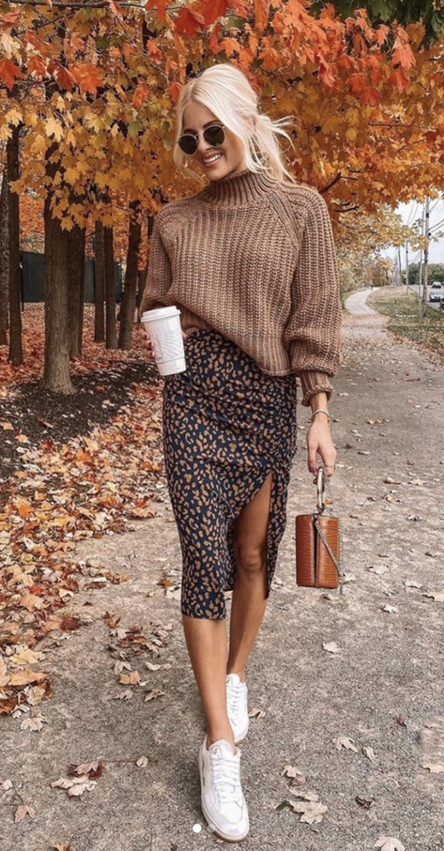 Cute Thanksgiving outfits with brown sweater, midi skirt and white sneakers