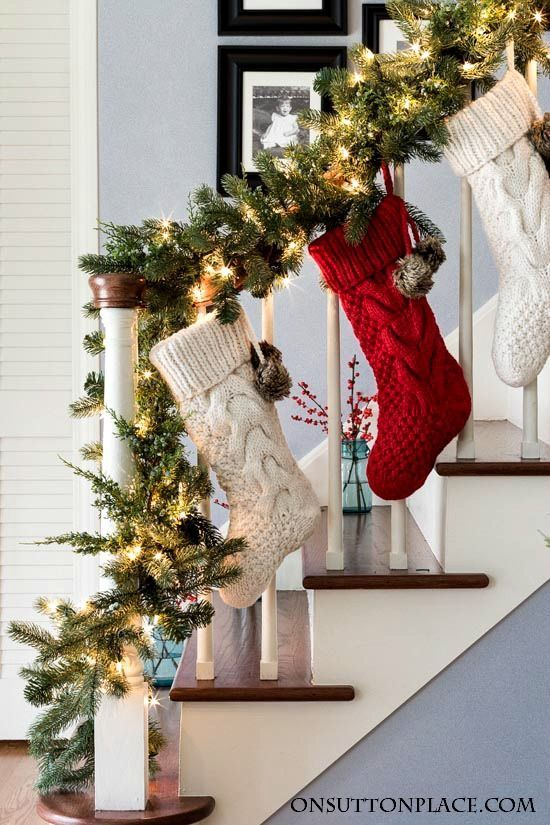 Easy Christmas entry decor and Christmas staircase decor ideas with Christmas stockings